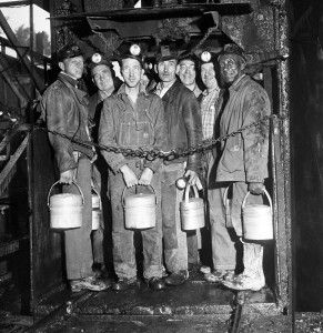 Red Lion, Pennsylvania, USA --- 6/1/1946- Red Lion, PA: Soft coal miners return to work... miners stand in the elevator cage, ready to descend into the H.C. Frick coke company mine at Red Lion, PA., near Connellsville, June 1st, to work their first shift since settlement of the soft coal strike. Pennsylvania'a 75,000 hard coal miners are still on strike while contract negotiations continue. PH: Edwin J. Morgan. --- Image by © Bettmann/CORBIS
